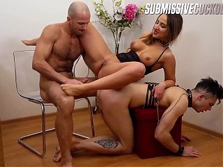 Busty domme cucks her slave